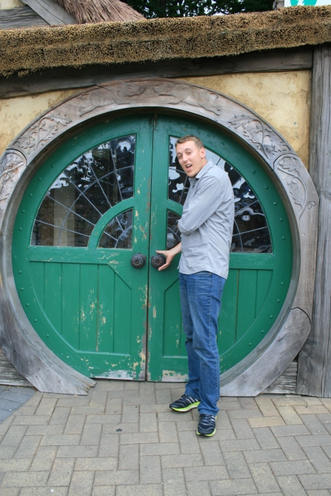Massive Hobbit door and him